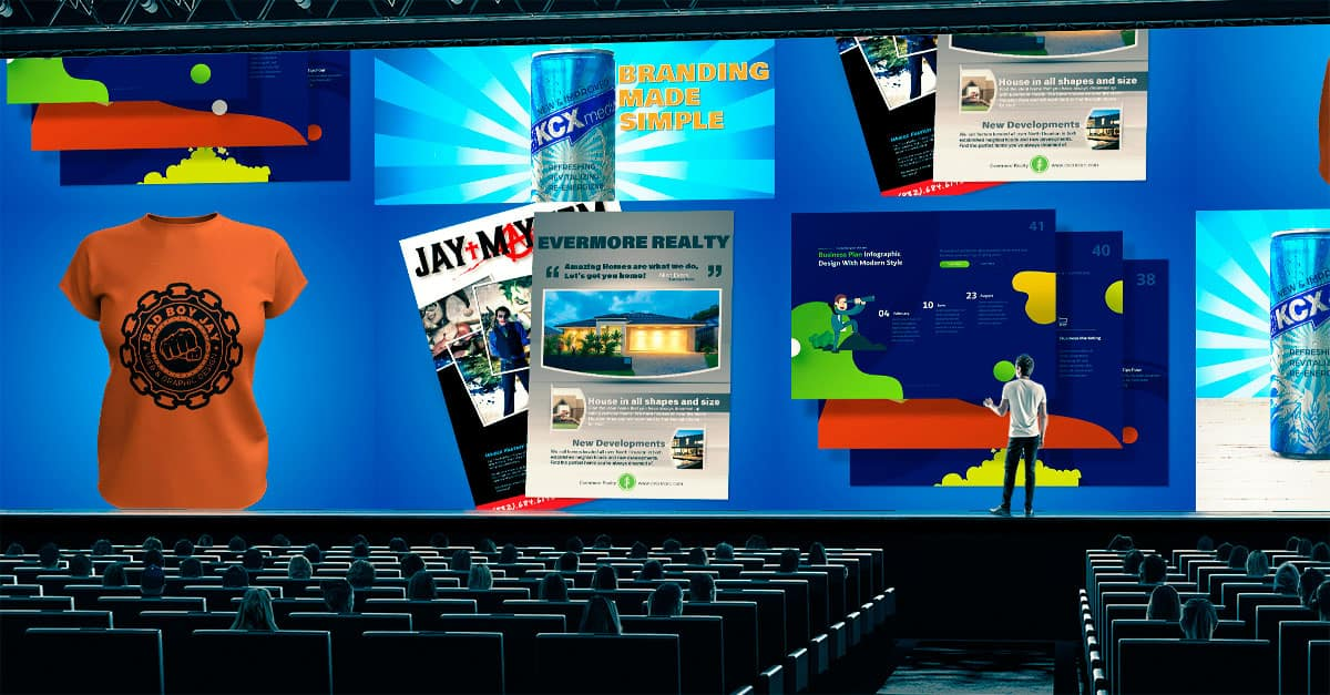 This is an image of a presentation hall, on the screen are several examples of our graphic design services. There is an energy drink ad, a couple of posters for different businesses, slide from a graphic design presentation, and a logo.